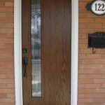 Flush fiberglass door with offset glass