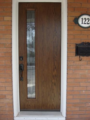 Flush fiberglass door with offset glass
